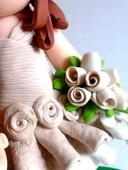Sposini con bimbo - Dettaglio vestito e bouquet